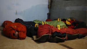 Bodies of climbers killed in an avalanche at Mount Manaslu lie covered with numbers at the Tribhuvan University Teaching hospital in Kathmandu, Nepal on Monday.