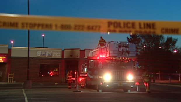 Firefighters mop up at a Northgate strip mall after a early morning fire.