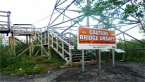 The 70-year-old suspension footbridge at Ross River, Yukon, has been closed due to safety concerns.