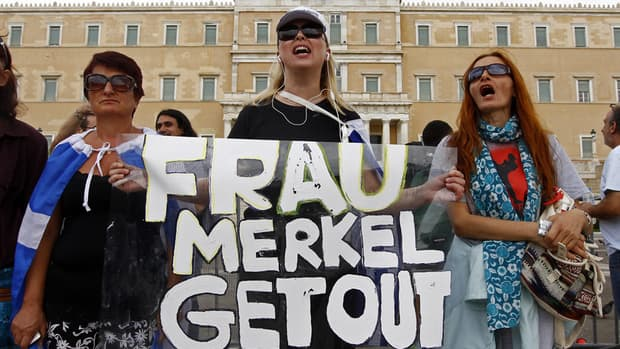 People gather ahead of a demonstration in central Athens against the visit of German Chancellor Angela Merkel.