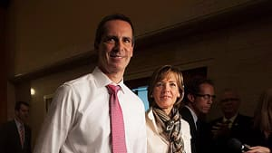 Ontario Premier Dalton McGuinty walks out of the government caucus room with his wife Terri after telling his MPPs he's stepping down.