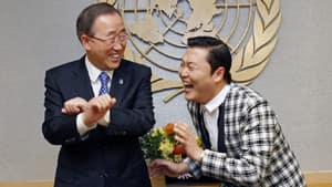 South Korean rapper PSY doubles over with laughter as UN Secretary General Ban Ki-moon, an admirer and fellow South Korean, attempts to learn the Gangnam Style dance.