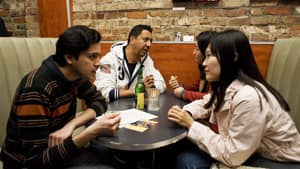 Kazim Rizei, left, Soonjin Choi, right, William Garcia, second left and Katie Yu practice English and Korean at a language exchange at the Rivoli Restaurant in Toronto on October 11.