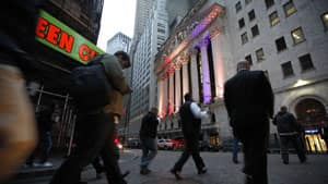 Traders and staff report to work at the New York Stock Exchange on Wednesday. Mayor Michael Bloomberg rang the opening bell at the storied trading floor on Wednesday after it was closed for two days because of superstorm Sandy.