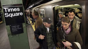 Passengers exit a downtown-bound subway train in New York's Times Square on Thursday.
