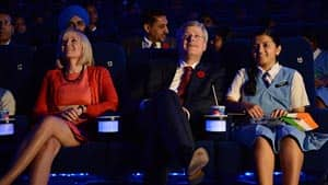 Prime Minister Stephen Harper and his wife, Laureen, along with Grade 10 student Suraksha and others from the Stella Maris Girls School, attend the opening of Bangalore's new IMAX theatre Thursday.