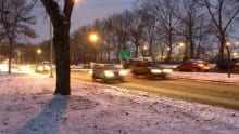 Wet roads and falling snow made for a slow commute Thursday morning.