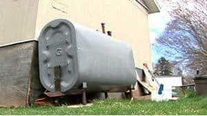 Some oil tanks are placed above ground like this one, and others are buried in the yards of houses.
