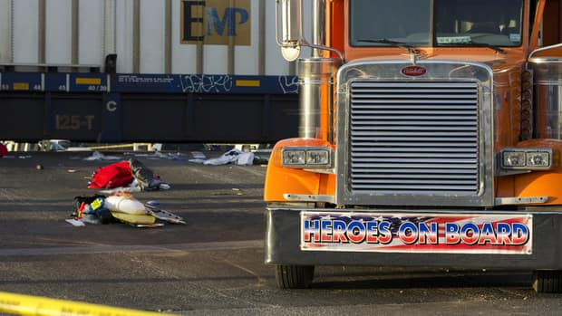 The freight train slammed into a parade float carrying wounded veterans.