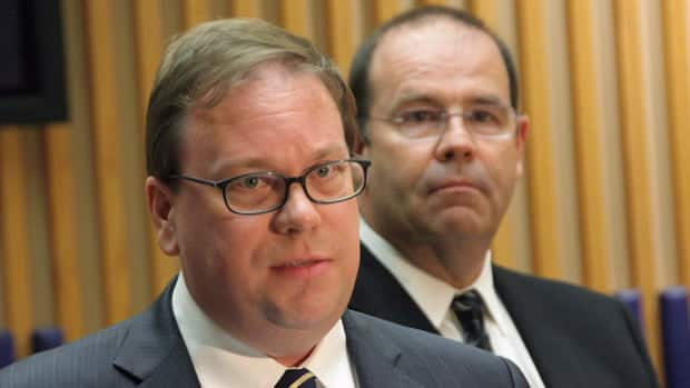 Ontario's chief forensic pathologist, Dr. Michael Pollanen (left), speaks at a news conference in Toronto on Wednesday, June 13, 2012 as the province's chief coroner, Dr. Andrew McCallum (right), looks on.