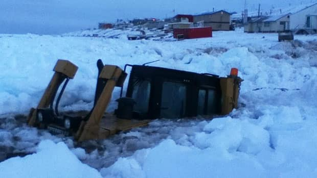 A heavy equipment driver in Pond Inlet, Nunavut, had a close call recently when his machine fell through the sea ice and sank up to its cab.