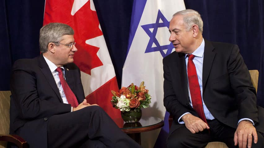 Prime Minister Stephen Harper is shown with Israel's Prime Minister, Benjamin Netanyahu, in late September. Canada has thrown its support behind Israel in two recent United Nations votes.