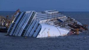 The half-sunk cruise ship Costa Concordia remains where it ran aground on Jan 13, 2012.