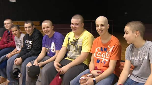 Chris Lewis (second from the right) and his friends show off their new hairstyles.