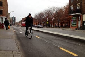 There's a curb to keep the cars away on some bike lanes in Montreal.