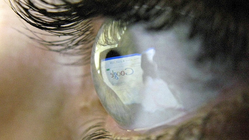 A computer screen is reflected in the eye of a web user. A U.S. movie studio is trying to compel a Canadian ISP to hand over customer data of alleged illegal dowloaders.
