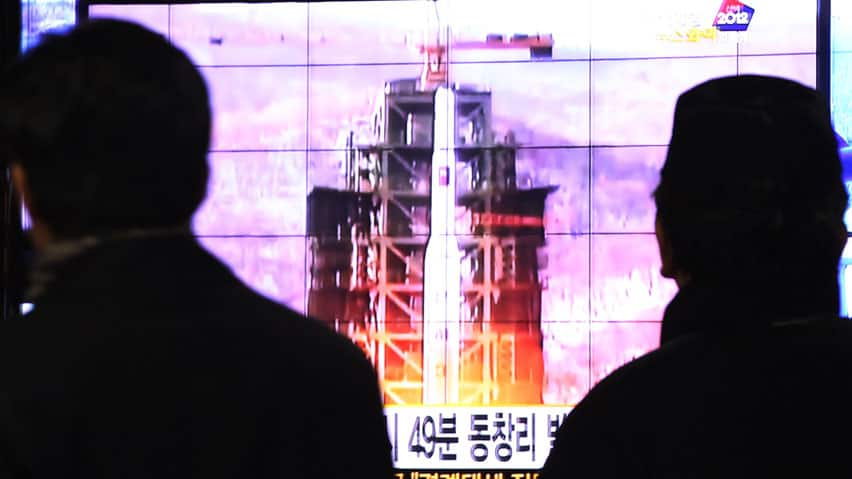 South Koreans watch a TV news report on the launch of the Unha rocket from Tongchang-ri, North Korea, at Seoul Railway Station on Wednesday.