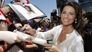 Canadian country singer Shania Twain signs autographs after unveiling her star on the Walk of Fame in Hollywood, California in 2011.  Twain's management company repatriated most of her memorabilia from the Shania Twain Centre in Timmins — including an entire tour bus — to Las Vegas, where the singer now has a regular show.