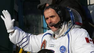 Canadian astronaut Chris Hadfield waves prior to the Soyuz launch at the Baikonur Cosmodrome in Kazakhstan on Wednesday.