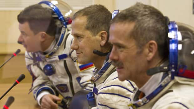 The International Space Station (ISS) crew members, from left: Russian cosmonaut Roman Romanenko, U.S. astronaut Thomas Marshburn and Canadian astronaut Chris Hadfield speak at the Baikonur cosmodrome, Kazakhstan, Dec. 19.