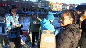 Idle No More activists in Whitehorse hand out bannock and information sheets on Main Street Friday.