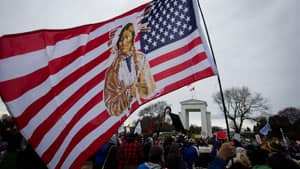 A protester waves a U.S. flag adorned with a Native American during an Idle No More demonstration at the Douglas-Peace Arch crossing near Surrey, B.C., Saturday.