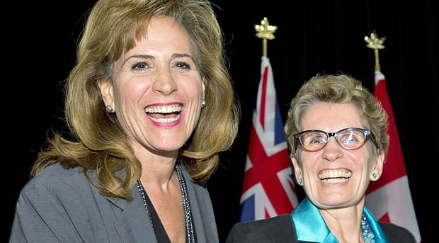 Ontario Liberal party leadership candidates Sandra Pupatello (left) and Kathleen Wynne share a laugh following a forum at in Toronto on Dec. 6, 2012. Both former cabinet ministers, they are viewed as frontrunners in the race and both have support among prominent Hamilton Liberals. (Frank Gunn/The Canadian Press)