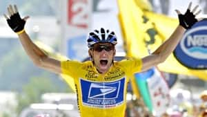 In this July 22, 2004, file photo, Lance Armstrong reacts as he crosses the finish line to win the 17th stage of the Tour de France cycling race between Bourd-d'Oisans and Le Grand Bornand, French Alps. In 2004, Armstrong was also named Associated Press Male Athlete of the Year and ESPN's ESPY Award for Best Male Athlete.