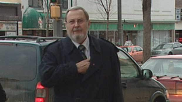 Peter Goldring walks into the Edmonton courthouse for the second day of his trial on Friday.