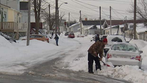 St. John's residents shovel snow on Wednesday morning.