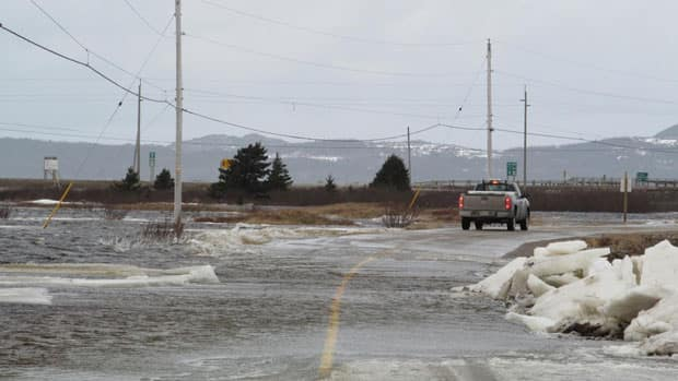 The Mattis Point Causeway is flooded with water and blocked with ice.
