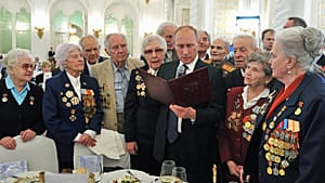 Russian President Vladimir Putin meets with Second World War veterans at a reception in Moscow marking the 70th anniversary of the Battle of Stalingrad.