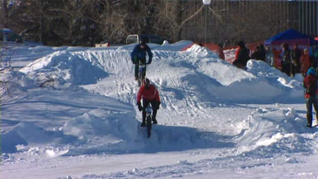 Cyclists rode through a winding, icy course built right on the lake.