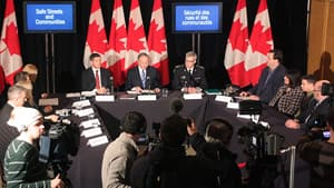 Justice Minister Rob Nicholson, centre, former NHL player and victims rights advocate Sheldon Kennedy, left, and OPP deputy commissioner Vince Hawkes, right, held a roundtable in Toronto Monday to preview the Harper government's future criminal justice measures.