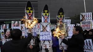South Korean protesters in Seoul burn pictures of North Korean leader Kim Jong Un after North Korea conducted a nuclear test on Tuesday.