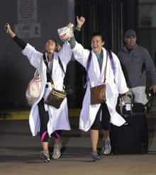 Kendall Jenkins, left, celebrates with her friend Brittany Ferguson after getting off the Carnival Triumph in Mobile, Ala.