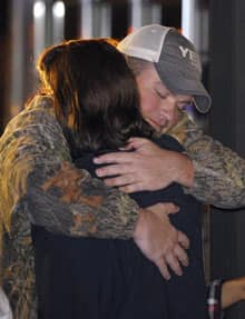 James Enmon hugs his aunt Kristi Conn, both of Orange, Texas, after getting off the cruise ship in Mobile.