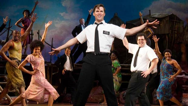Andrew Rannells, centre, performs with an ensemble cast in The Book of Mormon at the Eugene O'Neill Theatre in New York. The Tony Award-winning musical comes to Toronto on April 30 for a six-week run.