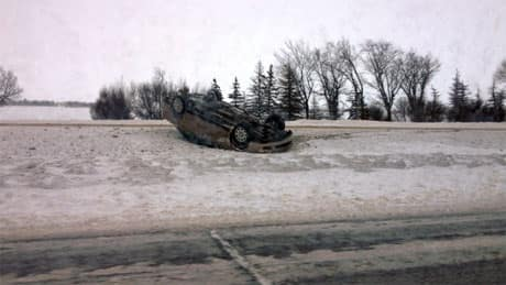 Police were kept busy with reports of jackknifed semis, cars and ditches and rollovers like this one on Regina's Ring Road.