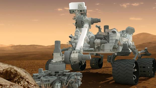 This artist's rendering provided by NASA shows the Curiosity rover on the surface of Mars.