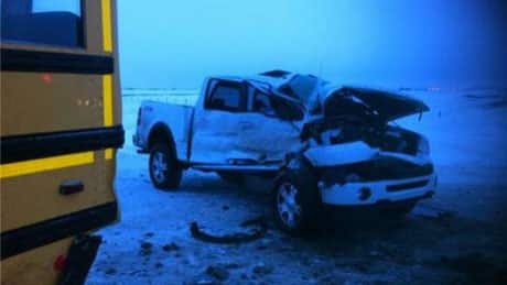 A man is in hospital after his pickup truck slammed into an empty school bus Thursday west of Regina.
