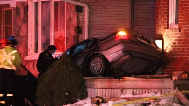 A vehicle crashed into a hydro pole landing on top a front porch in Etobicoke at about 2 a.m. Saturday.