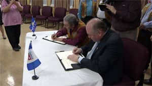 Tlicho Grand Chief Eddie Erasmus and N.W.T. Premier Bob McLeod officially sign the Tlicho government on to the N.W.T.'s devolution agreement-in-principle on Friday in Behchoko. The Tlicho are one of five aboriginal groups to sign on to the agreement.