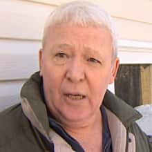 Mount Pearl resident Albert Caines says he's very happy with the robotic garbage collection system.