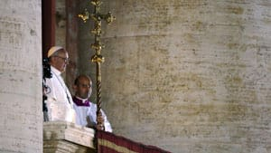 Bergoglio appears on the balcony overlooking St. Peter's Square minutes after French Cardinal Jean-Louis Tauran announced he was the pope elect.