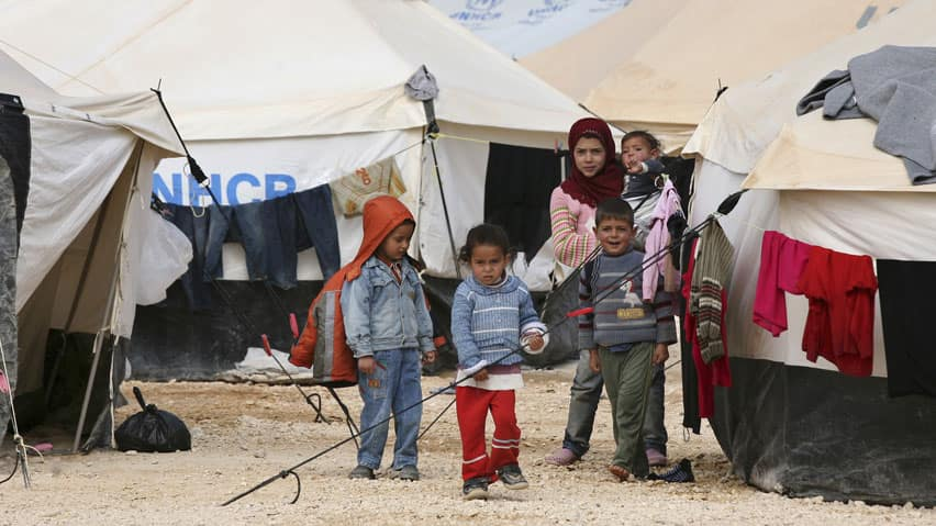 Syrian refugees children stand outside their tent at Al Zaatri refugee camp in the Jordanian city of Mafraq, near the border with Syria, March 6, 2013. UN refugee agency spokeswoman Reem Alsalem says Syrians are fleeing their country 'at a rate faster than anyone anticipated.'