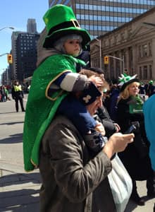 A young reveller awaits the arrival of the St. Patrick's Day parade in Toronto on Sunday afternoon.