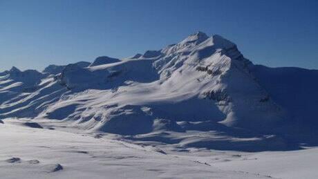 Effort to reach skier in glacier's crevasse stalled by weather