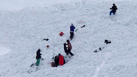 One of the skiers was rescued by the group after spending about four minutes trapped under the snow.