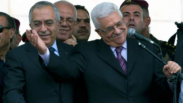 Salam Fayyad, left, has stepped down as prime minister following a dispute with Palestinian President Mahmoud Abbas, right.